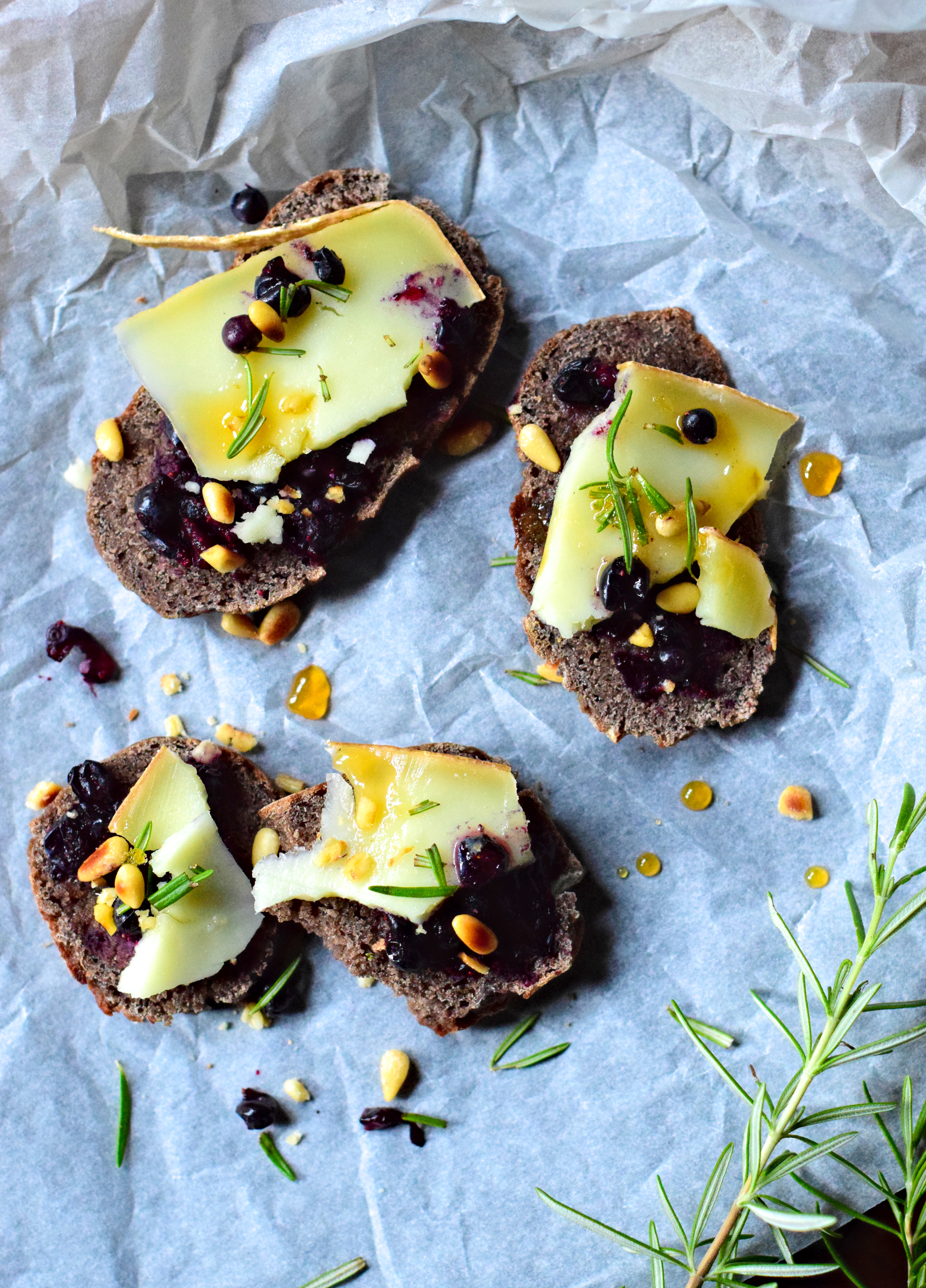 Buckwheat toasts with rosemary, sheep cheese & wild blueberries